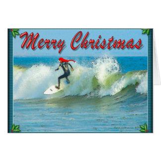 Tarjeta de Navidad de Santa que practica surf