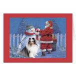 Tarjeta de Navidad de Sheltie Santa y muñeco de ni