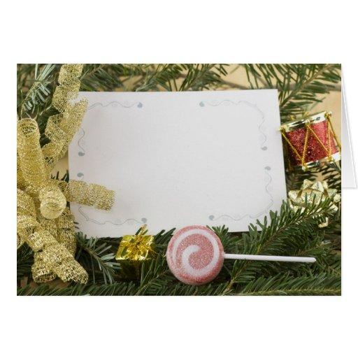 Tarjeta de Navidad del arco de la hoja de oro