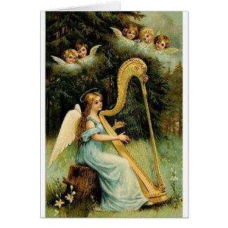 Tarjeta de Navidad del arpista del ángel del Victo