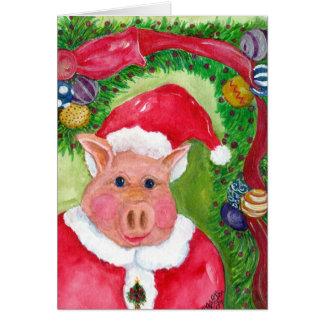 Tarjeta de Navidad del cerdo de Santa con la cinta