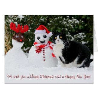 Tarjeta de Navidad del gato y del muñeco de nieve