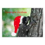 Tarjeta de Navidad del mapache que sube
