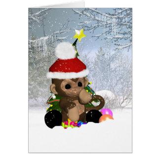 Tarjeta de Navidad del mono, mono lindo en nieve