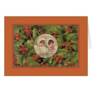 Tarjeta de Navidad del vintage con 2 chicas jóvene