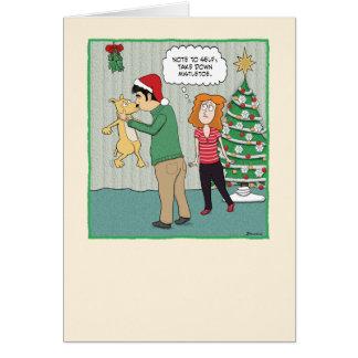 Tarjeta de Navidad divertida: Perro debajo del mué