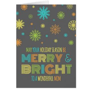 Tarjeta de Navidad feliz y brillante de la mamá co