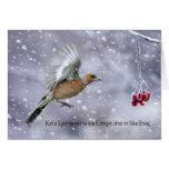 tarjeta de Navidad griega con el chaffinch en vuel