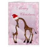 Tarjeta de Navidad linda de la jirafa de la mamá y