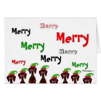 Tarjeta de Navidad muchos feliz de los Dachshunds