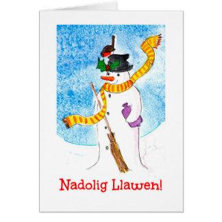 Tarjeta de Navidad, muñeco de nieve y petirrojo