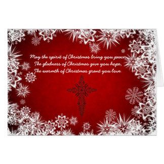 Tarjeta de Navidad roja con las escamas blancas de