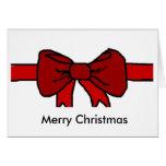Tarjeta de Navidad roja de la cinta