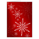 Tarjeta de Navidad roja de los copos de nieve