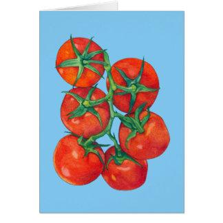 Tarjeta de nota azul roja de los tomates