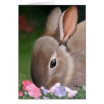 Tarjeta de nota del conejo y de las flores