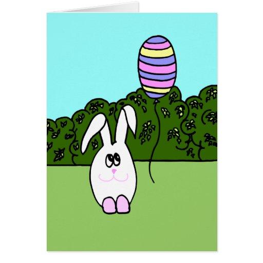 Tarjeta de pascua - el conejito blanco w adornó el