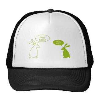 Tarjeta de pascua feliz con los conejitos verdes gorras de camionero