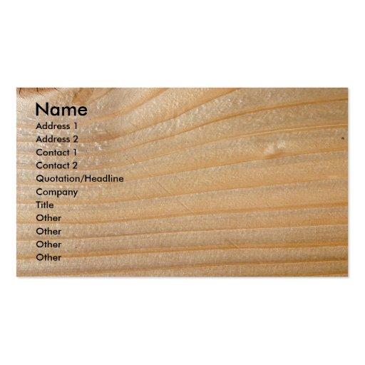 Tarjeta de visita en la madera inacabada
