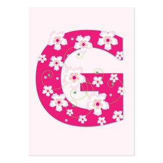 Tarjeta de visita floral rosada inicial de G del m