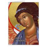 Tarjeta del ángel del navidad con escena de la nat