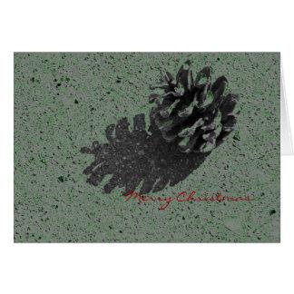 Tarjeta del cono del pino de las Felices Navidad d
