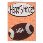 Tarjeta del fútbol del feliz cumpleaños en naranja