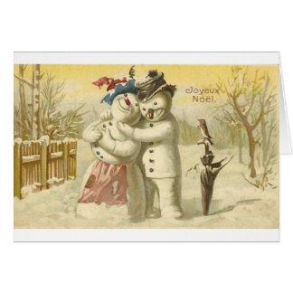 Tarjeta del muñeco de nieve y de la mujer de Joyeu