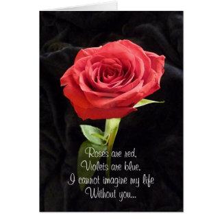 Tarjeta dramática de la oferta del rosa rojo con e