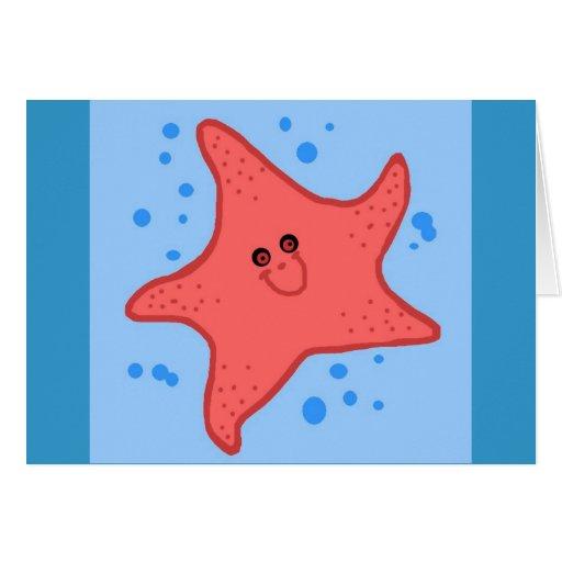 Tarjeta en blanco de las estrellas de mar felices