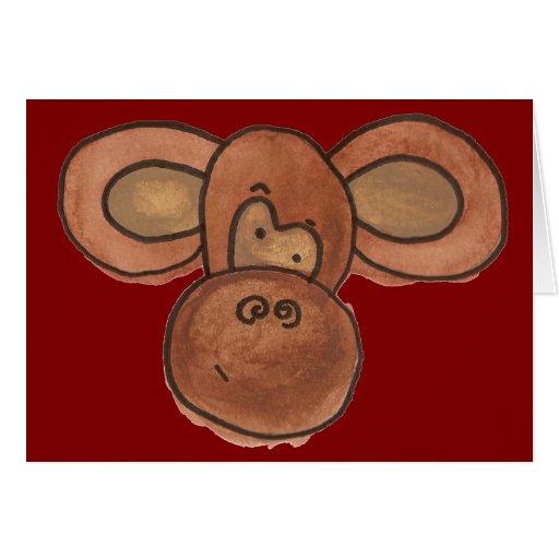Tarjeta en blanco del mono lindo del dibujo animad