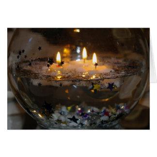 Tarjeta en blanco flotante de las velas