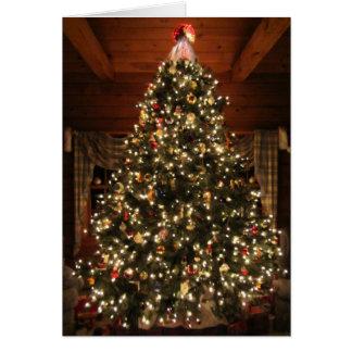 Tarjeta encendida del árbol de navidad