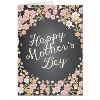 Tarjeta feliz del día de madre de la pizarra flora