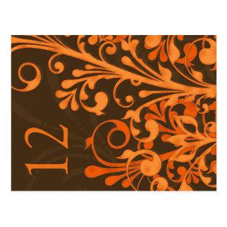 Tarjeta floral anaranjada de la tabla del boda de postales