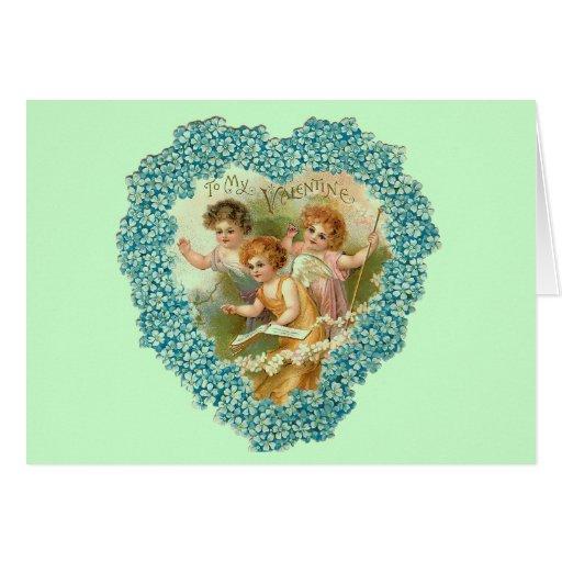 Tarjeta floral del corazón de las querubes del