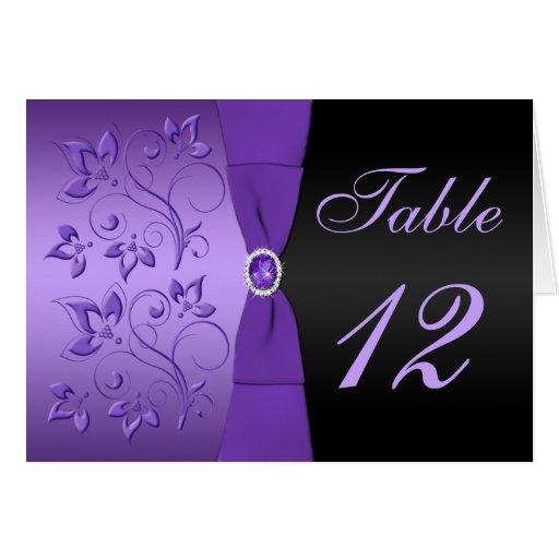 Tarjeta floral púrpura y negra del número de la ta