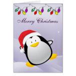 Tarjeta linda del pingüino y de las luces de
