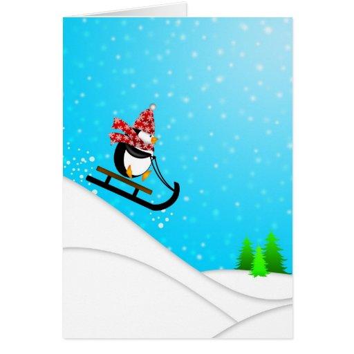 Tarjeta linda del trineo de la nieve del pingüino