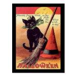 Tarjeta negra del gato de Halloween del vintage