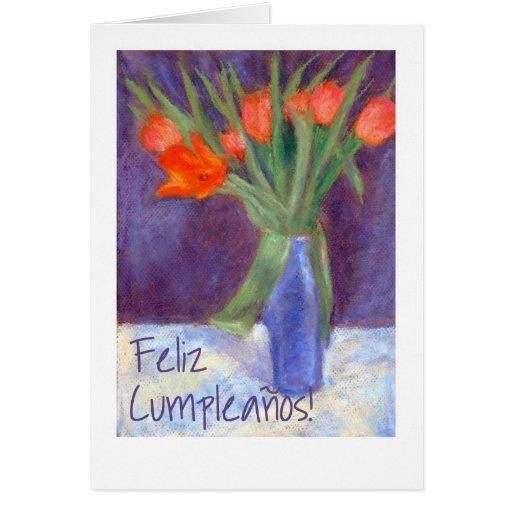 Tarjeta roja de los tulipanes del cumpleaños - sal
