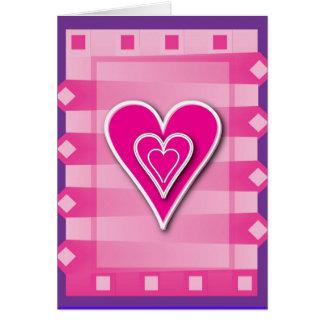 Tarjeta rosada de los corazones