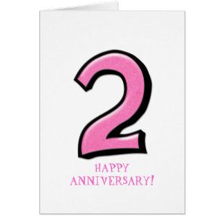 Tarjeta rosada del aniversario de los números 2
