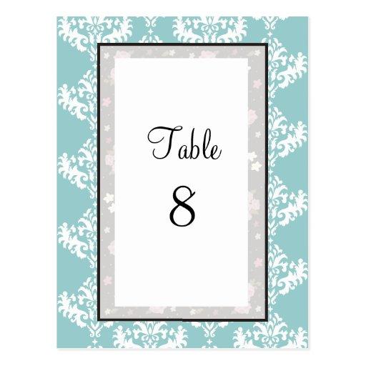 Tarjetas azules y blancas del número de la tabla d tarjetas postales