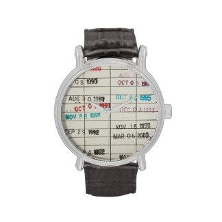 Tarjetas de fecha debida de la biblioteca del reloj de mano