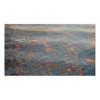 Tarjetas de visita de la puesta del sol del agua d