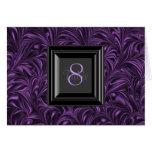 Tarjetas púrpuras y negras de la tabla del boda