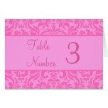 Tarjetas rosadas del número de la tabla de la rece