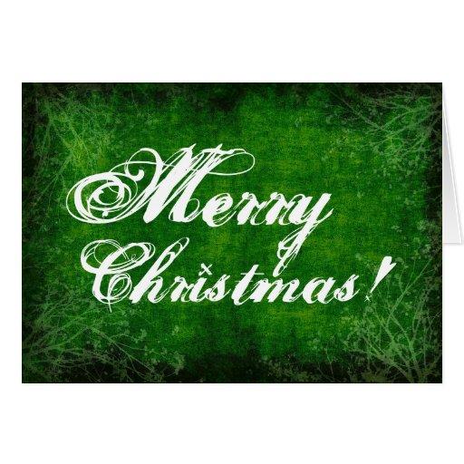 Tarjetas verdes de las Felices Navidad del fondo