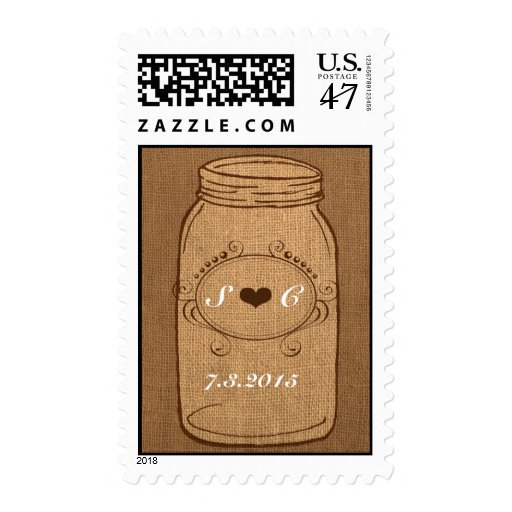 Tarro de albañil rústico en el boda del vintage de sello postal